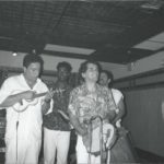 1989 - Cavaquinista Carlinos pandeirista Ivo Araújo and singer George Silva performing with samba band Kilombo dos Palmares